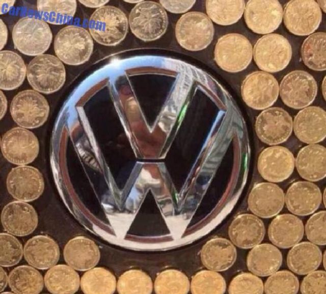 china-volkswagen-beetle-covered-in-coins-is-so-money_2
